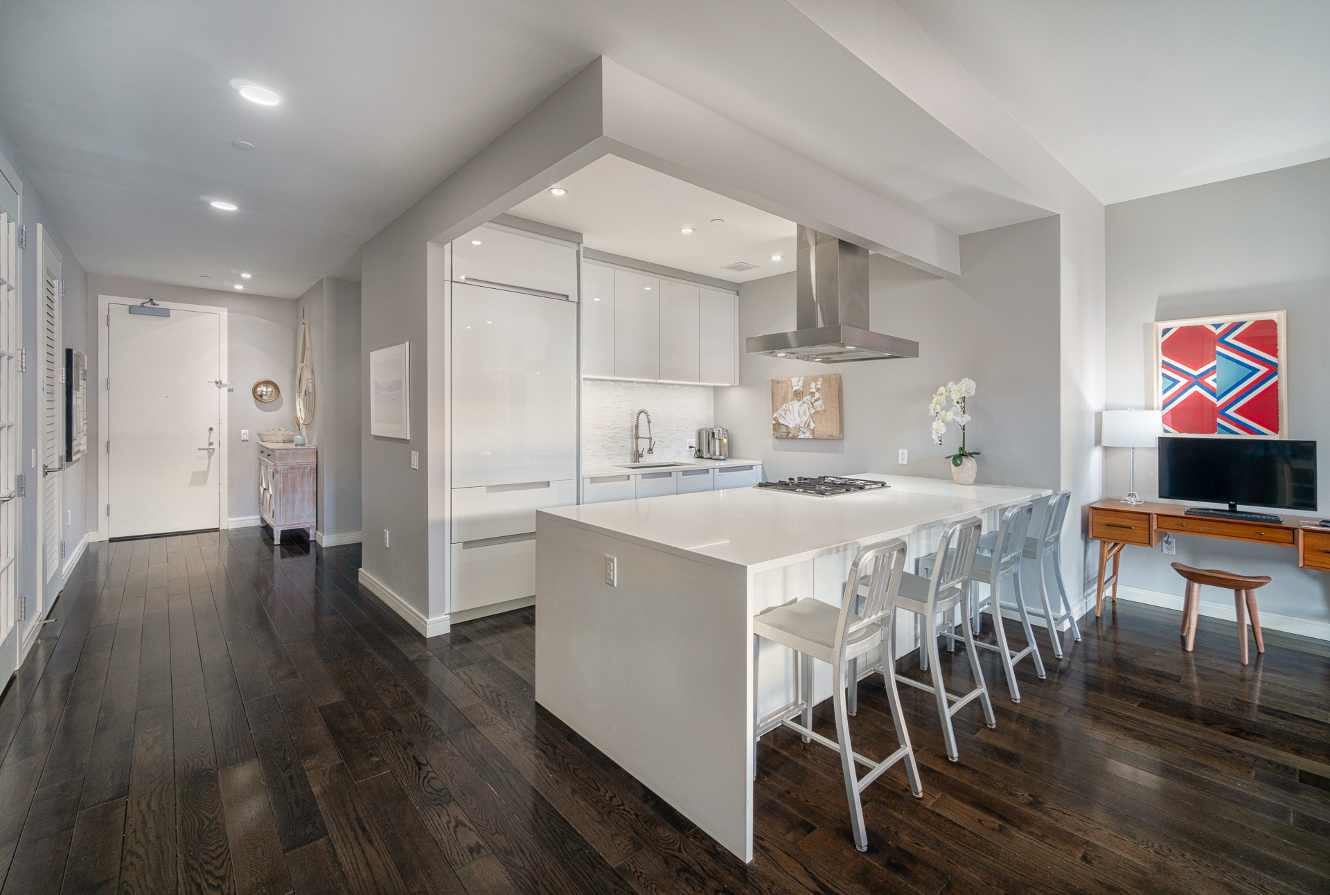 In TriBeCa's landmark historic district, this 2 bedroom, 3-bathroom, luxury home with an office is spectacular with a great layout and modern finishes. You enter through a long hallway into the stunning open concept kitchen and living space. The apartment brandishes 10-foot ceilings, 5-inch plank oak floors, an open concept living room, chef's kitchen with Poggenpohl cabinetry, white quartz countertops, imported glass tile backsplash, Sub-Zero refrigerator, and Bosch stove, range and dishwasher. The master suite has an oversized custom walk-in closet and the marble clad master bath sports a walk-in shower, 6-foot Catalina soaking tub, and porcelain dual sinks. The second bedroom is spacious and has an on-suite bathroom. The home office/accessory space (currently setup as a nursery) has French doors that provides privacy when needed and could easily accommodate a queen bed with room to spare to provide an additional sleeping space. The unit includes three full baths. The home comes complete with a Bosch washer and dryer and Sonos ready speakers. The 24/7 doorman building hosts impressive amenities including a fitness center, children's playroom, library, 61-foot pool, sauna, 5000 square foot common roof terrace with panoramic views, sundeck, lounge and dining area. The neighborhood offers some of the best restaurants in the city as well as the Hudson River waterfront (Piers 25 and 26) and close proximity to Whole Foods.