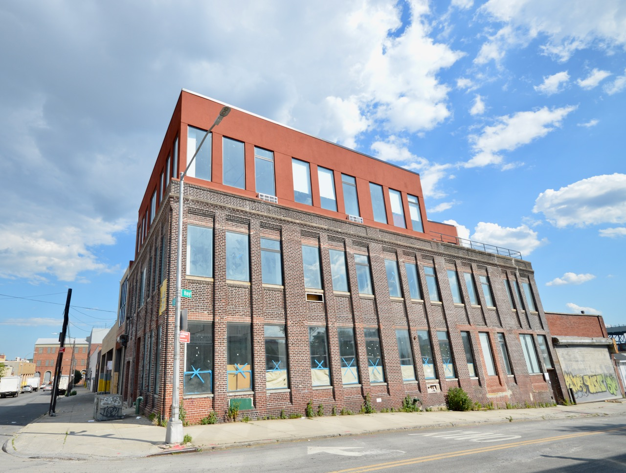 At the crossroads of Carroll Gardens and Gowanus is 425 Hoyt Street, a 24,000 sf industrial warehouse that has been transformed for today's commercial needs. Built in 1931 and recently renovated, this 3 story, corner brick building is the hot property in the area. 425 Hoyt Street is a stunning transformation that has been outfitted with all new mechanicals, oversized casement windows, and a large steel case passenger elevator. There is a large loading dock on the Hoyt Street side with an overhead door, and a large drive in garage on 4th Street. The building's new roof offers panoramic views of Brooklyn, the Gowanus Canal, and the large new Gowanus Park located a stone's throw from the Hoyt Street side of the property. Poured concrete floors and a mixture of the buildings industrial past and new sleek renovations fuse the old and new seamlessly. New oversized skylights flood the interior with light. In addition to the expansive roof of the building there is a large second floor outdoor space framed by huge steel case windows. A new large capacity passenger elevator connects all floors.  The property is an ideal fit for film and tv production, and is easily accessible by train and highway. Smith Street is only 1 block away which has a great mix of all the types of businesses that have made Brooklyn what it is today. Because of its size, the building would work well for high end office space, film and tv production, a school, or a high end manufacturing operation with a retail component.  As office space, the building would work well for everything from a tech firm, to a corporate office looking to escape the daily grind and close quarters of Manhattan.  Shown by appointment.  Broker's welcome! 3 Story Corner Brick Factory Building with New Elevator Renovated for Todays Commercial Office and Production Needs Delivered Vacant